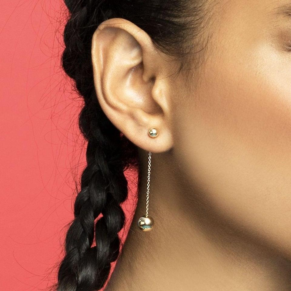 """<h3>The Last Line Double Sphere Drop Earrings<br></h3> <br>This single, lengthy drop earring makes the perfect anchor for an asymmetrical assortment of earrings.<br><br><em>Shop <strong><a href=""""https://thisisthelast.com/"""" rel=""""nofollow noopener"""" target=""""_blank"""" data-ylk=""""slk:The Last Line"""" class=""""link rapid-noclick-resp"""">The Last Line</a></strong></em><br><br><strong>The Last Line</strong> Double Gold Sphere Drop Earrings, $, available at <a href=""""https://go.skimresources.com/?id=30283X879131&url=https%3A%2F%2Fthisisthelast.com%2Fproducts%2Fdouble-sphere-drop-earring-14k-yellow-gold"""" rel=""""nofollow noopener"""" target=""""_blank"""" data-ylk=""""slk:The Last Line"""" class=""""link rapid-noclick-resp"""">The Last Line</a><br><br><br>"""