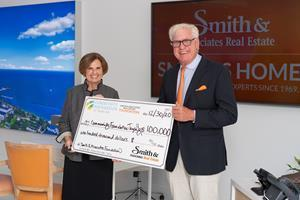 Bob Glaser, CEO & President of Smtih & Associates Real Estate present a $100,000 check to Marlene Spalten, President and CEO, Community Foundation of Tampa Bay