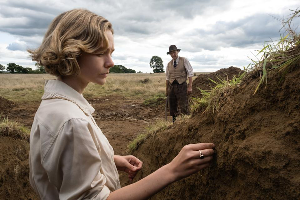 "Carey Mulligan and Ralph Fiennes in ""The Dig"" on Netflix. (Photo: Larry Horricks/Netflix)"