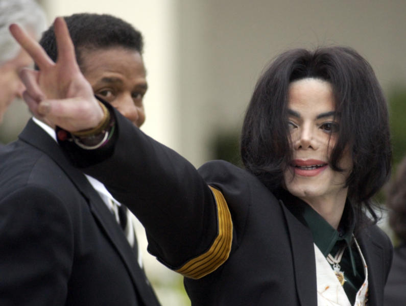 FILE - In this March 2, 2005, file photo, pop icon Michael Jackson waves to his supporters as he arrives for his child molestation trial at the Santa Barbara County Superior Court in Santa Maria, Calif. A California appeals court is strongly inclined to give new life to lawsuits filed by two men who accuse Michael Jackson of molesting them when they were boys.