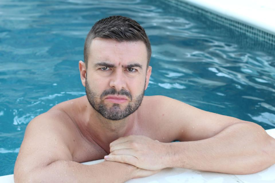 Angry man in swimming pool.