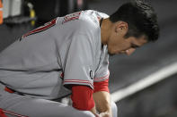 Cincinnati Reds starting pitcher Riley O'Brien reacts in the dugout after being pulled during the second inning of his major league debut in a baseball game against the Chicago White Sox Tuesday, Sept. 28, 2021, in Chicago. (AP Photo/Paul Beaty)