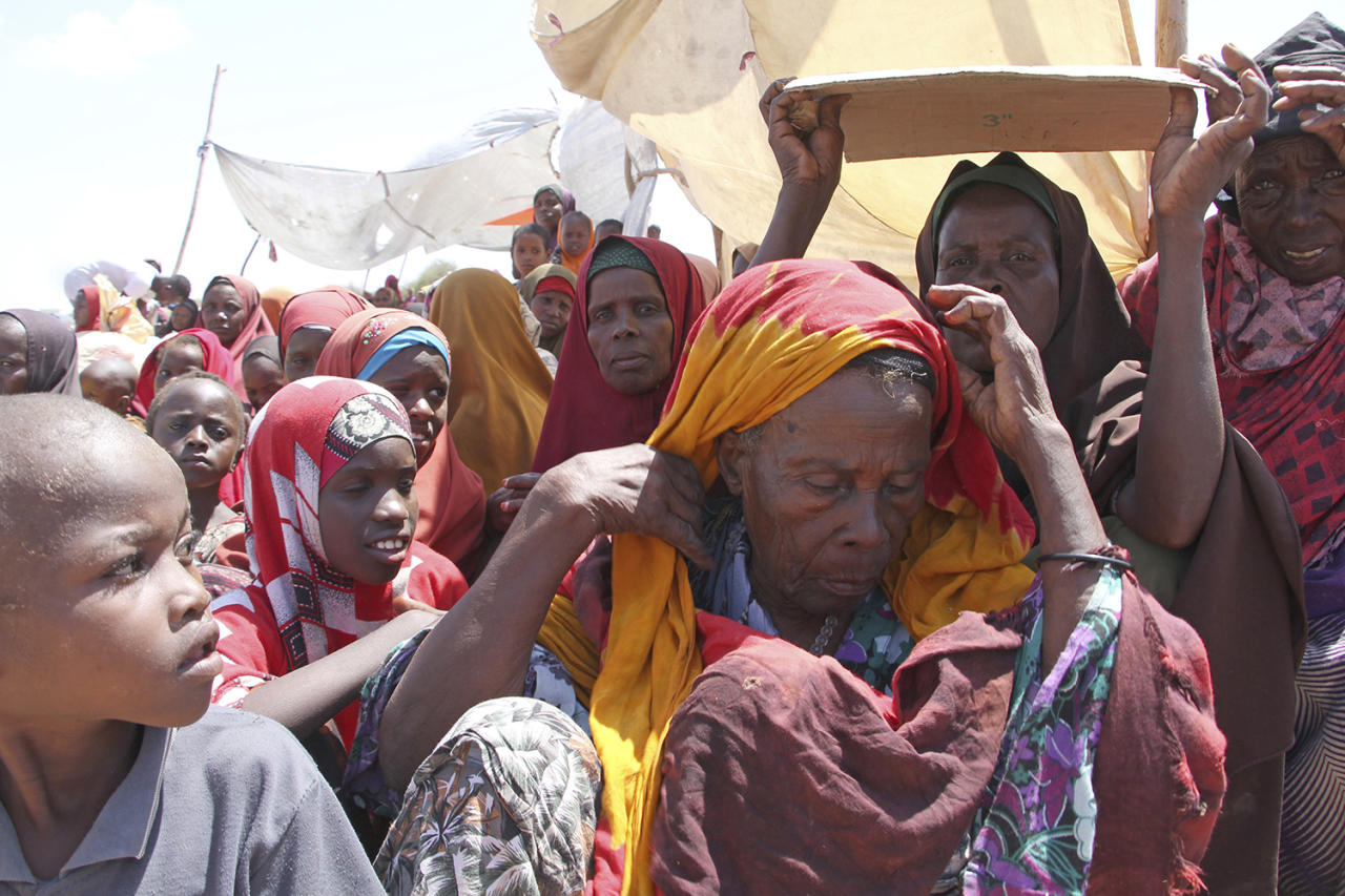 <p>Newly displaced Somali women and children gather, just outside of Mogadishu, in Somalia, Monday, March, 27, 2017. Somalia's drought is threatening 3 million lives, according to the U.N. In recent months, aid agencies have been scaling up their efforts but they say said more support is urgently needed to prevent the crisis from worsening. (Farah Abdi Warsameh/AP) </p>