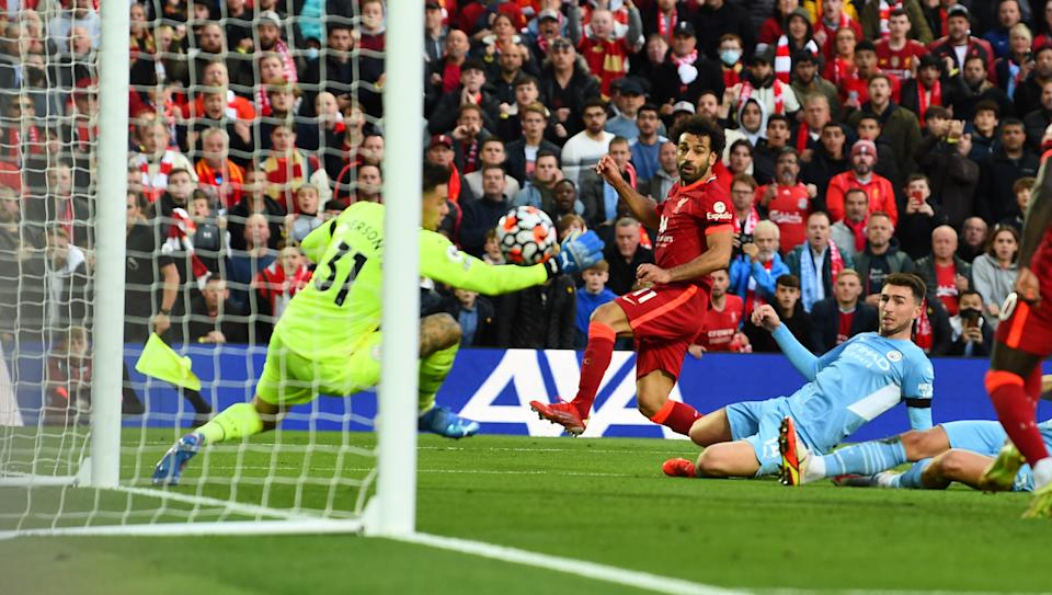 Mohamed Salah of Liverpool scores their second goal against Manchester City at Anfield.