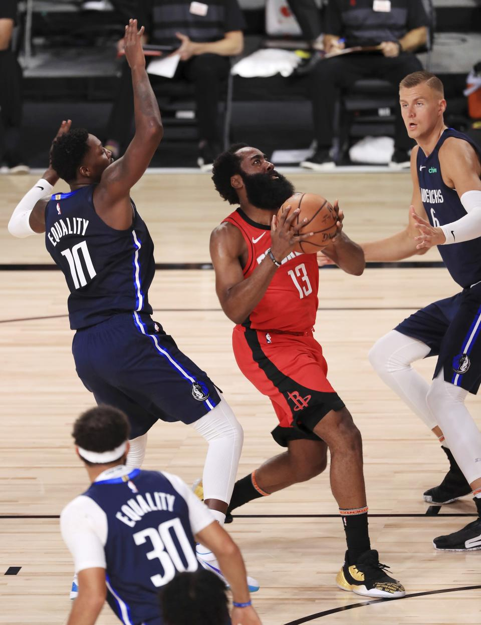 Houston Rockets James Harden (13) drives to the basket against the Dallas Mavericks during the first half of an NBA basketball game Friday, July 31, 2020, in Lake Buena Vista, Fla. (Mike Ehrmann/Pool Photo via AP)