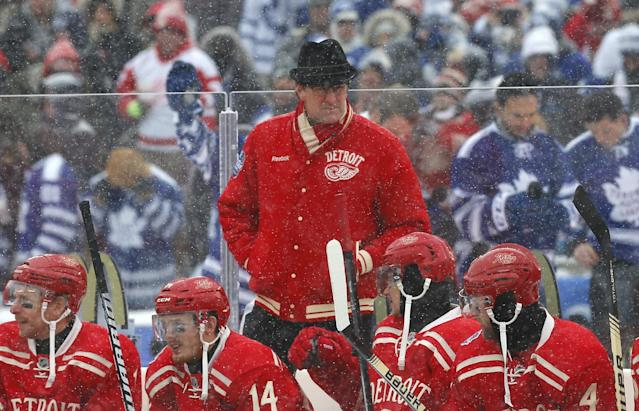 Detroit Red Wings head coach Mike Babcock, center, works behind the bench during the first period of the Winter Classic outdoor NHL hockey game against the Toronto Maple Leafs at Michigan Stadium in Ann Arbor, Mich., Wednesday, Jan. 1, 2014. (AP Photo/Paul Sancya)