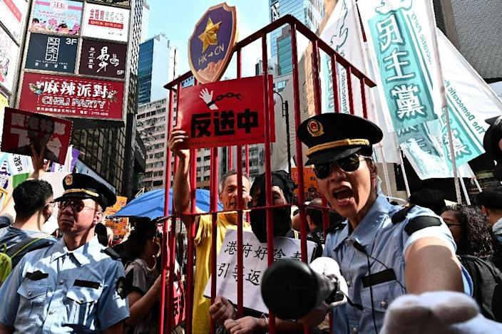 Hong Kong leader Carrie Lam has argued the extradition bill must be passed to plug existing loopholes (AFP Photo/Anthony WALLACE)
