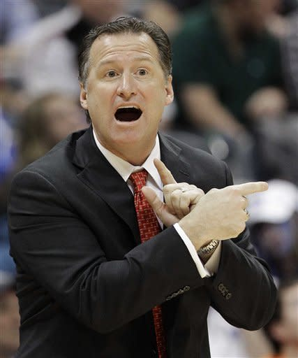 North Carolina State head coach Mark Gottfried calls a play against North Carolina during the first half of an NCAA college basketball game in the semifinals of the Atlantic Coast Conference tournament, Saturday, March 10, 2012, in Atlanta. (AP Photo/Chuck Burton)