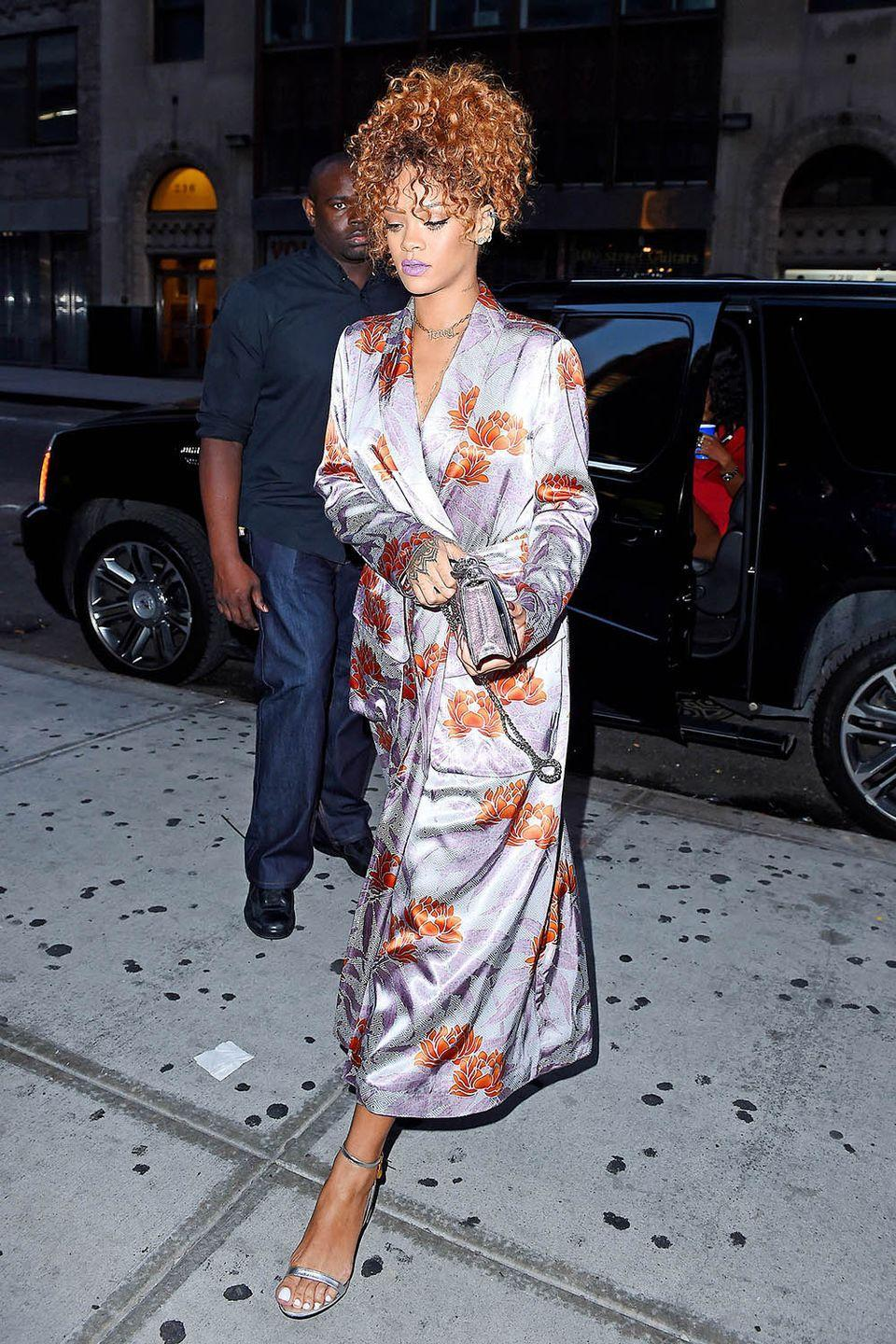 <p>Reinventing wedding attire by sporting a silk robe with a silver bag and heels to her stylist's nuptials in NYC</p>