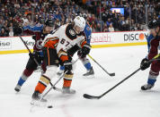 Anaheim Ducks left wing Rickard Rakell (67) chases down the puck in the corner as Colorado Avalanche center Tyson Jost (17) defends during the second period in an NHL hockey game Wednesday, March 4, 2020 in Denver. (AP Photo/John Leyba)