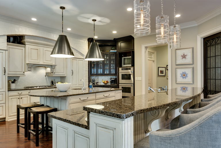 "<p>This dated the French country kitchen lacked style and function before lifestyle blogger Kelly Page of Bluegraygal enlisted designer Jessica Bradley to give it a <a href=""https://www.housebeautiful.com/design-inspiration/home-makeovers/a32287744/bluegraygal-kelly-page-kitchen-renovation/"" rel=""nofollow noopener"" target=""_blank"" data-ylk=""slk:makeover"" class=""link rapid-noclick-resp"">makeover</a>. The double islands were originally less than ideal. One of them had a bar sink, and you had to walk around it to get to the garbage or dishwasher.</p>"