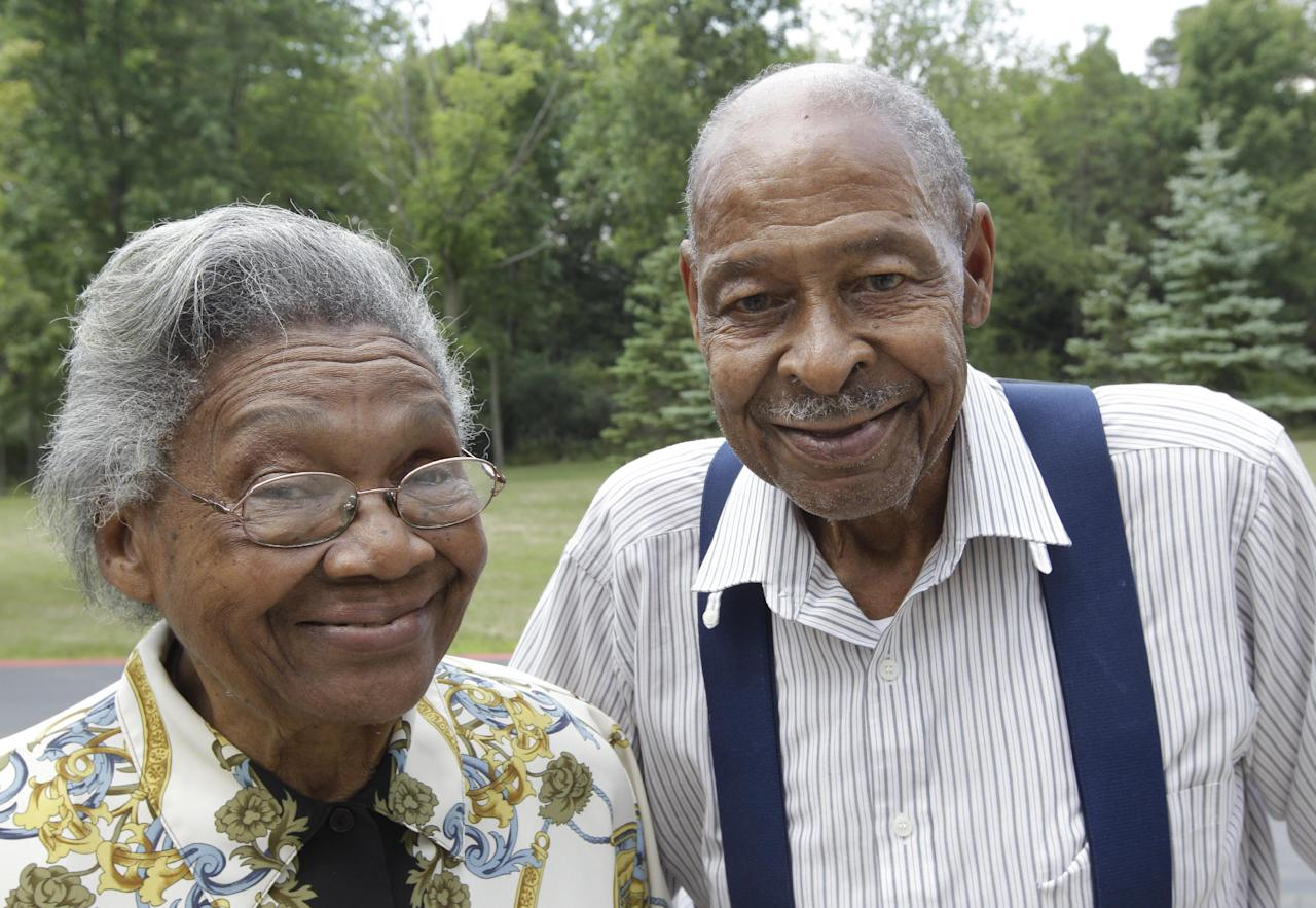 Roland Davis and Lena Henderson, both 85, pose for a photo in West Seneca, N.Y., Tuesday, July 31, 2012. They got married while still in their teens, divorced 20 years later and are getting remarried on Saturday, August 4, after nearly a half-century apart. (AP Photo/David Duprey)