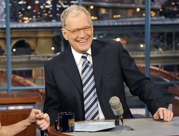 """FILE - In this Jan. 3, 2011 file photo provided by CBS Broadcasting, host David Letterman is shown on the """"Late Show with David Letterman,"""" in New York. CBS announced Tuesday, April 3, 2012 that both Letterman and Craig Ferguson have re-upped to keep hosting their respective hours _ """"Late Show"""" and """"The Late Late Show"""" _ through 2014. (AP Photo/CBS Broadcasting, John Paul Filo)."""