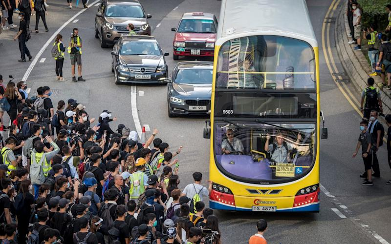 Demonstrators walk out onto Harcourt Road during a protest in the Admiralty district of Hong Kong, China, on Sunday, July 21, 2019. - Bloomberg