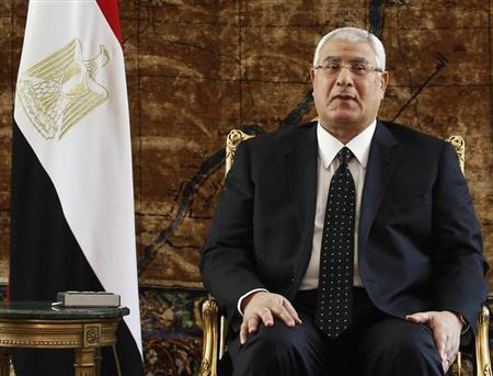 Egypt's interim President Adly Mansour attends a meeting with Egyptian and Russian officials in Cairo