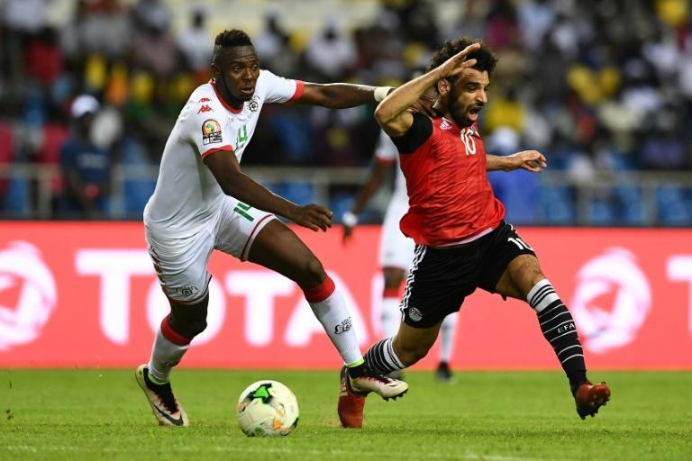 Renaissance Berkane defender Issoufou Dayo (L) challenges Mohamed Salah while playing for Burkina Faso against Egypt in a 2017 Africa Cup of Nations semi-final.