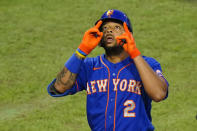 New York Mets' Dominic Smith reacts after hitting a home run off Philadelphia Phillies pitcher Spencer Howard during the third inning of a baseball game, Friday, Aug. 14, 2020, in Philadelphia. (AP Photo/Matt Slocum)