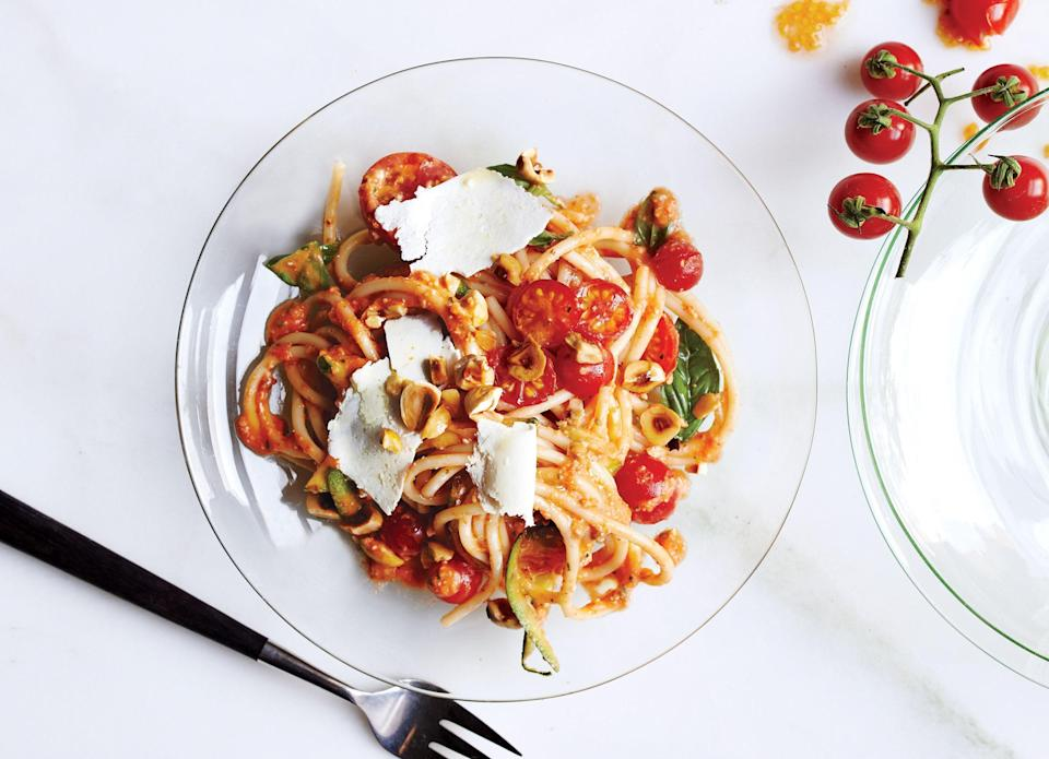 """This raw tomato sauce gets texture from zucchini and body from toasted nuts that are blended into the base. You can sub almonds for hazelnuts. <a href=""""https://www.bonappetit.com/recipe/spaghetti-no-cook-tomato-sauce-hazelnuts?mbid=synd_yahoo_rss"""" rel=""""nofollow noopener"""" target=""""_blank"""" data-ylk=""""slk:See recipe."""" class=""""link rapid-noclick-resp"""">See recipe.</a>"""