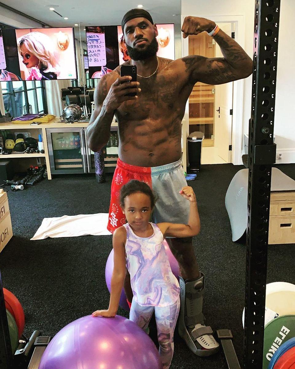 """<p>The NBA champ and his six-year-old daughter Zhuri showed off their muscles after spending time in their home gym. """"My workout partner today!"""" <a href=""""https://www.instagram.com/p/CNIuHU_htBq/"""" rel=""""nofollow noopener"""" target=""""_blank"""" data-ylk=""""slk:wrote the basketball player"""" class=""""link rapid-noclick-resp"""">wrote the basketball player</a>, adding the hashtag """"#JamesGang."""" </p>"""