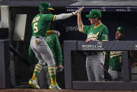 Oakland Athletics' Tony Kemp (5) is congratulated by manager Bob Melvin after hitting a three-run home run during the sixth inning of the team's baseball game against the New York Yankees on Friday, June 18, 2021, in New York. (AP Photo/Frank Franklin II)