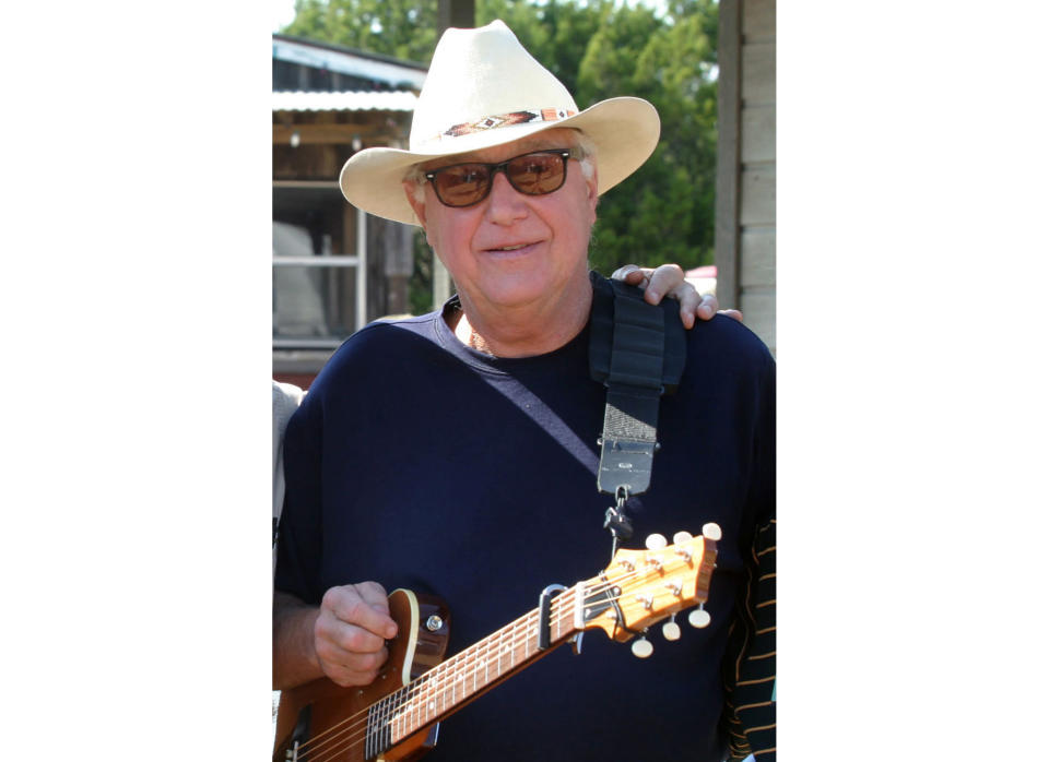 """FILE - This Oct. 30, 2005 file photo shows Country singer Jerry Jeff Walker at a campaign fundraiser at Willie Nelson's ranch outside Austin, Texas. The Texas country singer and songwriter who wrote the pop song """"Mr. Bojangles,"""" has died at age 78. Family spokesman John T. Davis says Walker died Friday, Oct. 23, 2020 of cancer after battling throat cancer and other health issues for several years. (AP Photo/Jack Plunkett)"""