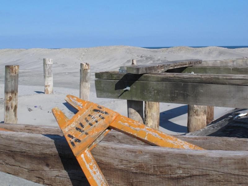 In this Feb. 12, 2013 photo, a saw horse sits atop the remnants of Avon, N.J.'s boardwalk, which was destroyed by Superstorm Sandy. Dogged by legal and environmental woes, Avon is lagging behind some other Jersey shore towns in terms of quickly rebuilding storm-damaged boardwalks. (AP Photo/Wayne Parry)