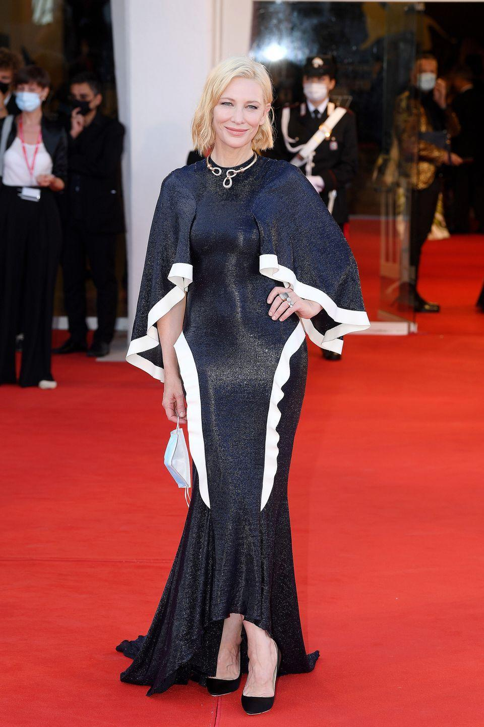 <p>Cate Blanchett wears a shimmery navy blue dress with voluminous sleeves by Esteban Salazar, black pumps by Clergerie, and jewelry by Pomellato. </p>