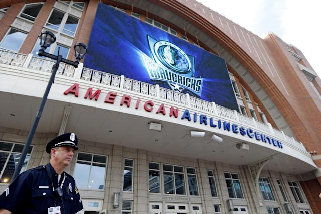 Dallas police detective Warren Breedlove stands outside American Airlines Center before an NBA basketball game between the Dallas Mavericks and the Memphis Grizzlies, Monday, April 15, 2013, in Dallas. Breedlove said that regular security officers were moved from their posts inside to keep watch outside the building following explosions at the Boston Marathon finish line on Monday. (AP Photo/Sharon Ellman)