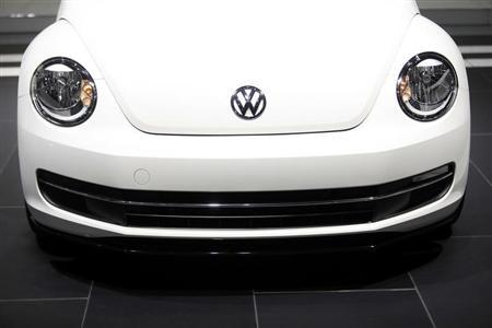 The Volkswagen logo is displayed on a 2014 Beetle TDI during the North American International Auto Show in Detroit,