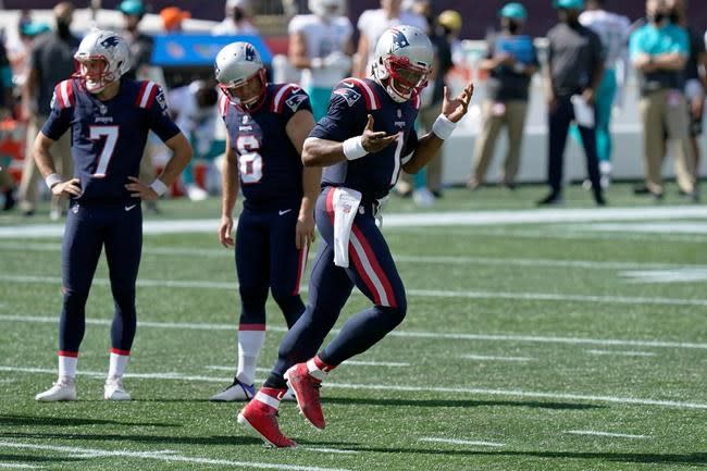 Newton runs for 2 TDs, Patriots hold off Dolphins 21-11