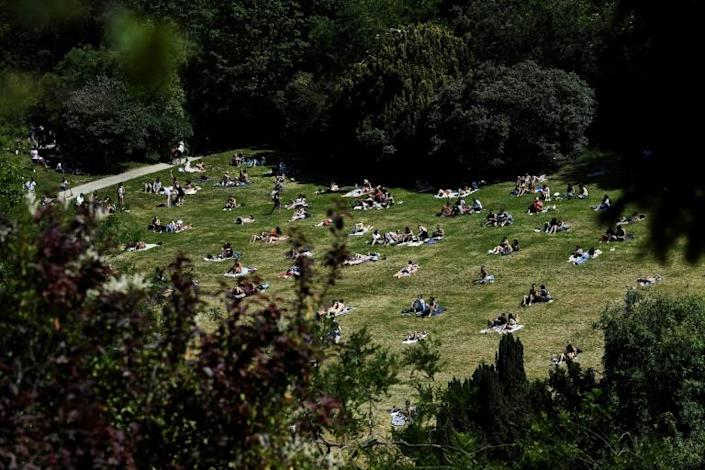 People enjoy the sun in Paris's Parc des Buttes Chaumont, as the French capital reopens it parks and gardens (AFP Photo/ALAIN JOCARD)