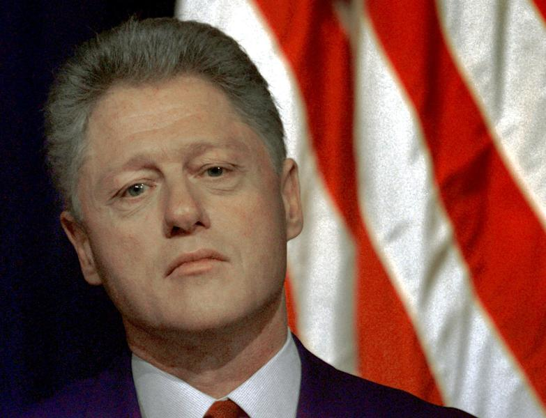 FILE - This Dec. 7, 1998 file photo shows President Bill Clinton waiting to speak at the White House in Washington. Second presidential terms are never easy. More often, they're fraught with peril, frequently marred by scandal, failure, hubris, and burnout and souring relations with Congress. (AP Photo/Greg Gibson, File)