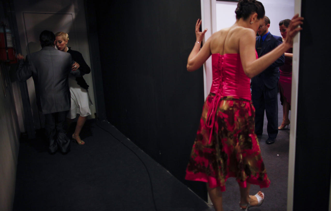 Dancers prepare backstage before competing in the 2012 Tango Dance World Cup salon finals in Buenos Aires, Argentina, Monday, Aug. 27, 2012. Argentina's annual tango competition, the highlight of a two-week festival which this year honored Astor Piazzolla, the legendary composer and bandoneonista who revived the genre and infuriated purists by blending tango with rock music in the 1970s. (AP Photo/Natacha Pisarenko)