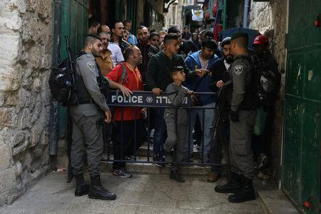 Israeli border police secure an alley following a stabbing attack inside the old city of Jerusalem