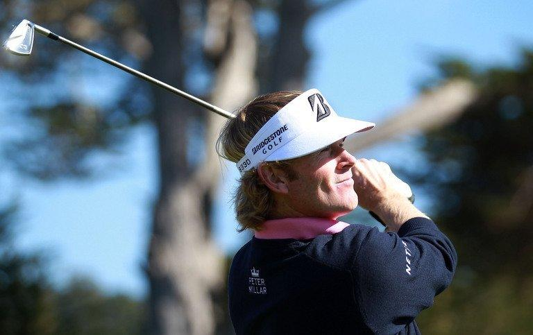 Brandt Snedeker watches his tee shot on the 17th hole on February 9, 2013 in Pebble Beach, California