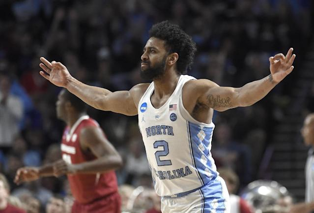 North Carolina's Joel Berry II (2) reacts after making a three-point basket against Arkansas during the first half in a second-round game of the NCAA men's college basketball tournament in Greenville, S.C., Sunday, March 19, 2017. (AP Photo/Rainier Ehrhardt)