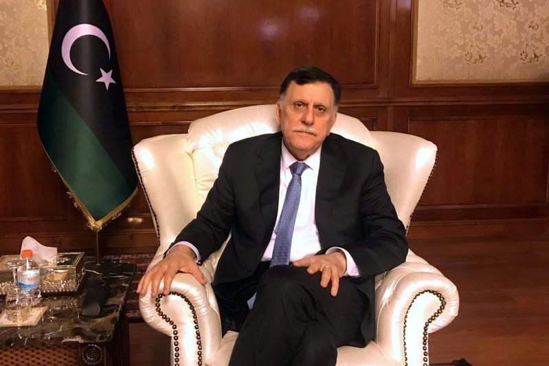 FILE PHOTO: Libya's internationally recognised PM al-Serraj is seen during an interview in Tripoli