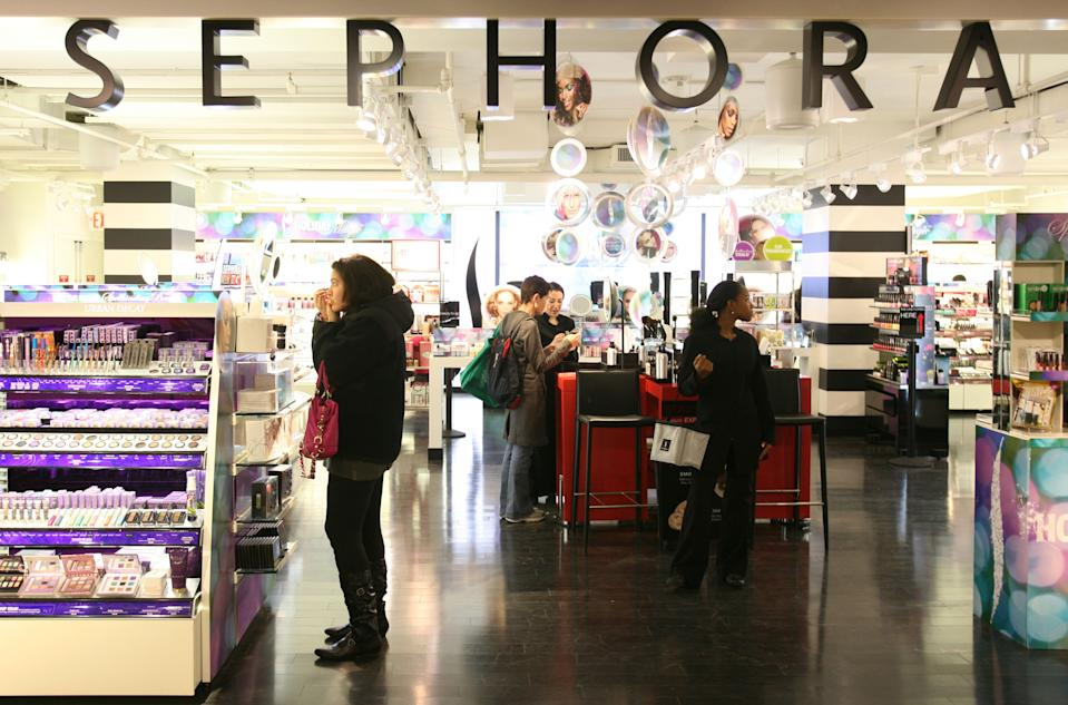 In this Friday, Oct. 23, 2009 photo, shoppers  visit a Sephora boutique inside a J.C. Penney store in New York. (AP Photo/Mark Lennihan)