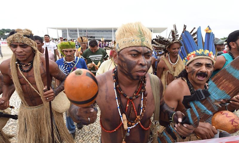 Demonstrators held spears and bows and arrows, in traditional battle gear