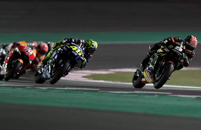 Motorcycle Racing - Qatar Motorcycle Grand Prix - MotoGP race - Losail, Qatar - March 18, 2018 - Movistar Yamaha MotoGP rider Valentino Rossi of Italy and Monster Yamaha Tech 3 rider Johann Zarco of France compete. REUTERS/Ibraheem Al Omari