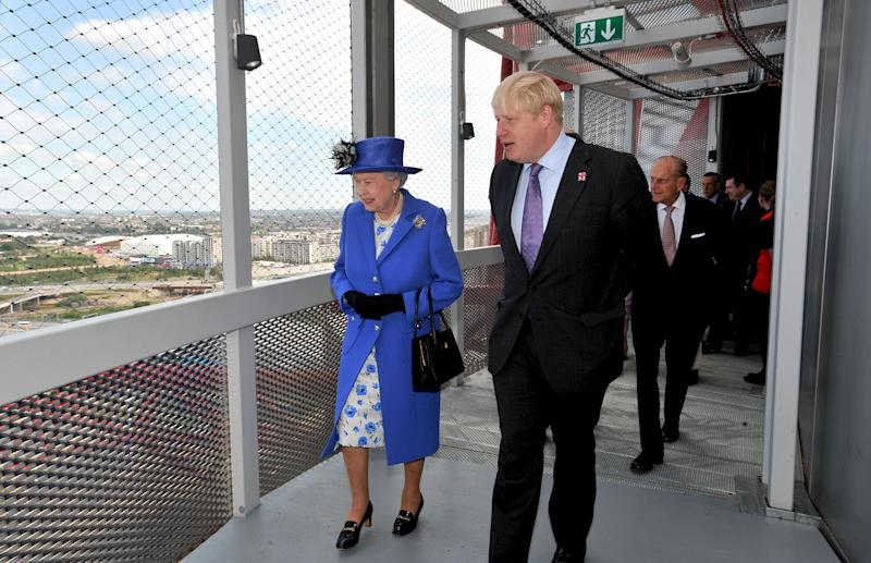 The Queen and Boris Johnson, when he was London Major, during a short tour of the Olympic site in Stratford, in 2012. [Photo: PA]