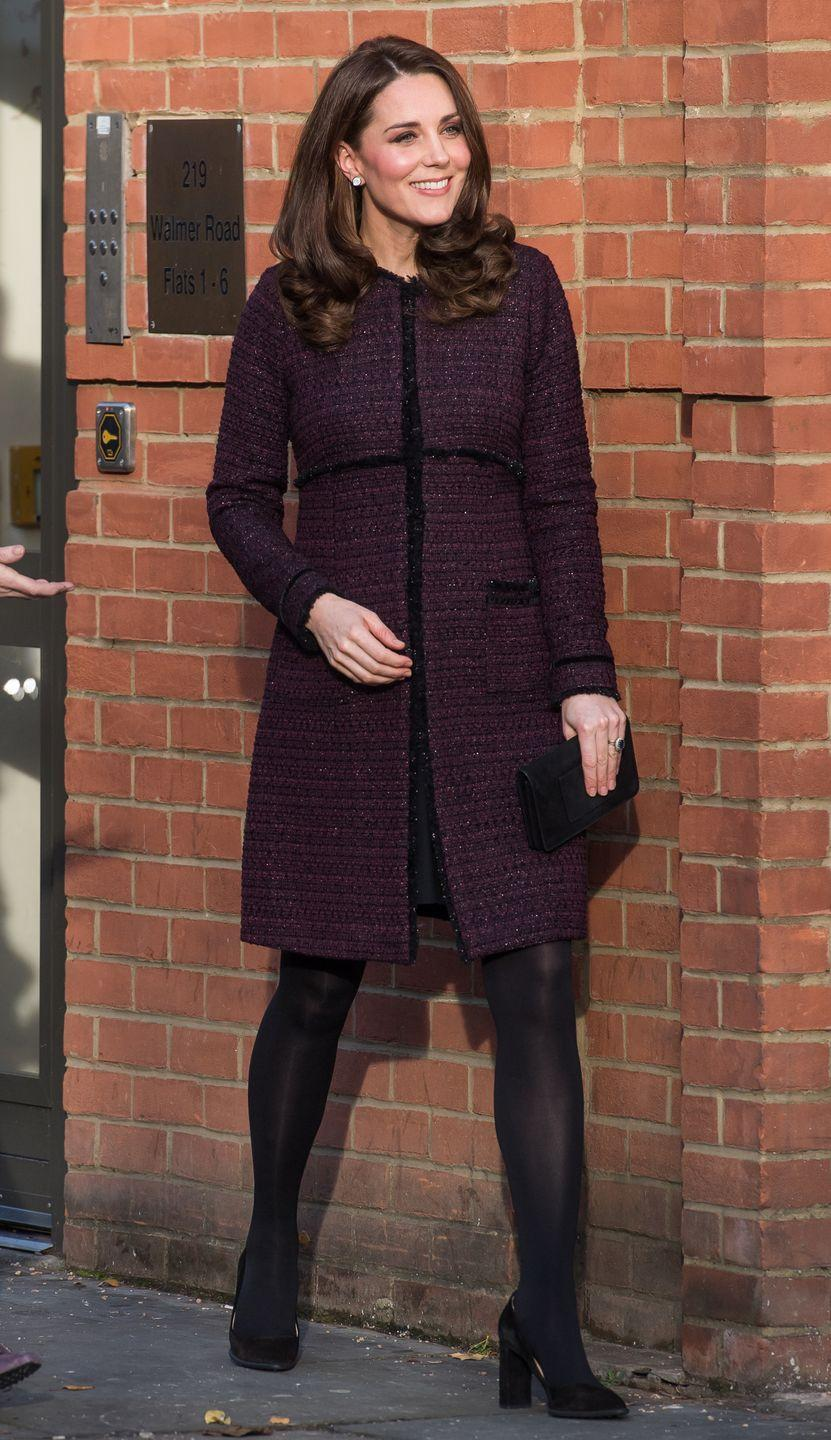 <p>The Duchess wears a plum Seraphine maternity coat, black tights, black pumps, and a black clutch during while visiting the 'Magic Mums' community Christmas party held at Rugby Portobello Trust in London.</p>