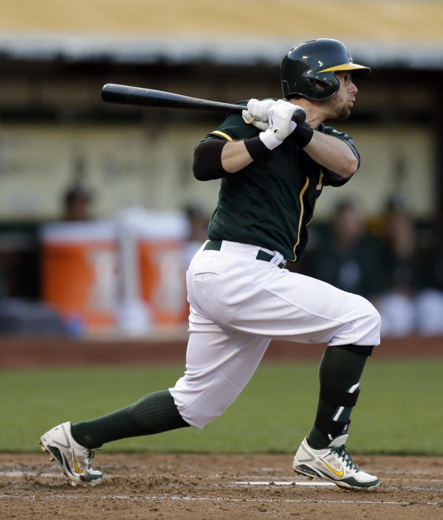 Oakland Athletics' Eric Sogard swings for a two-run single off New York Yankees' Hiroki Kuroda in the second inning of a baseball game on Saturday, June 14, 2014, in Oakland, Calif. (AP Photo/Ben Margot)