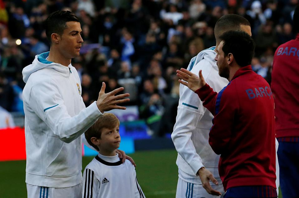 Cristiano Ronaldo (left) and Lionel Messi finally get to team up on our worldwide best XI of the decade. (REUTERS/Stringer)