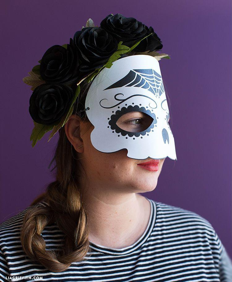 """<p>Celebrate Día de los Muertos a day early with this fun (and sew-free) sugar skull mask. </p><p><strong><em>Get the tutorial at <a href=""""https://liagriffith.com/papercut-sugar-skull-mask/"""" rel=""""nofollow noopener"""" target=""""_blank"""" data-ylk=""""slk:Lia Griffith"""" class=""""link rapid-noclick-resp"""">Lia Griffith</a>. </em></strong></p>"""