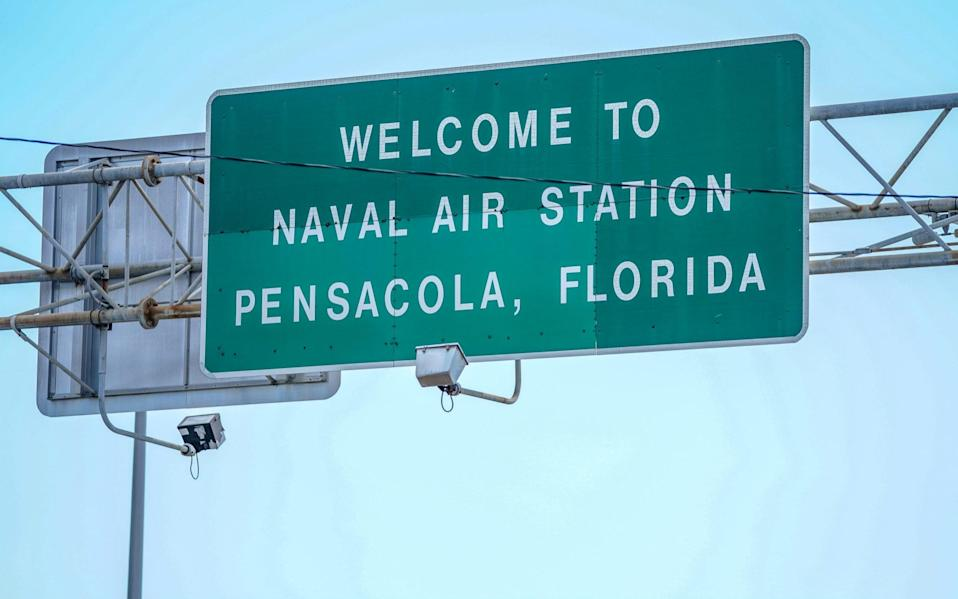 Signage located above the Bayou Grande Bridge leading to the Pensacola Naval Air Station following a shooting on December 06, 2019 in Pensacola, Florida. The second shooting on a U.S. Naval Base in a week has left three dead plus the suspect and seven people wounded. - Getty Images North America
