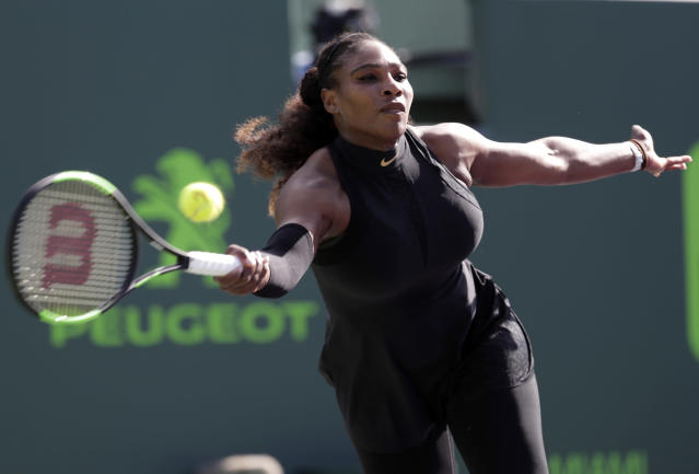 FILE - In this March 21, 2018, file photo, Serena Williams makes a return against Naomi Osaka, of Japan, during the Miami Open tennis tournament in Key Biscayne, Fla. Serena Williams will be competing in the French Open tennis tournament that begins on Sunday, May 27.(AP Photo/Lynne Sladky, File)