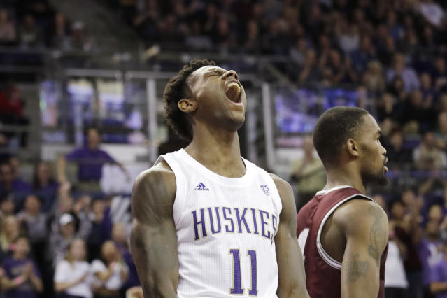 Washington's Nahziah Carter tips back his head and lets out a yell after being fouled while making a shot against Montana during the second half of an NCAA college basketball game Friday, Nov. 22, 2019, in Seattle. (AP Photo/Elaine Thompson)