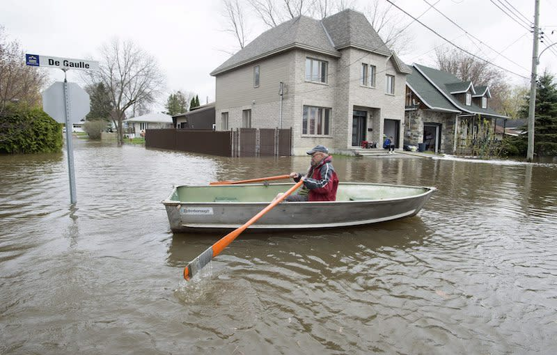 Canada's Quebec battles floods; police search for toddler, man swept away