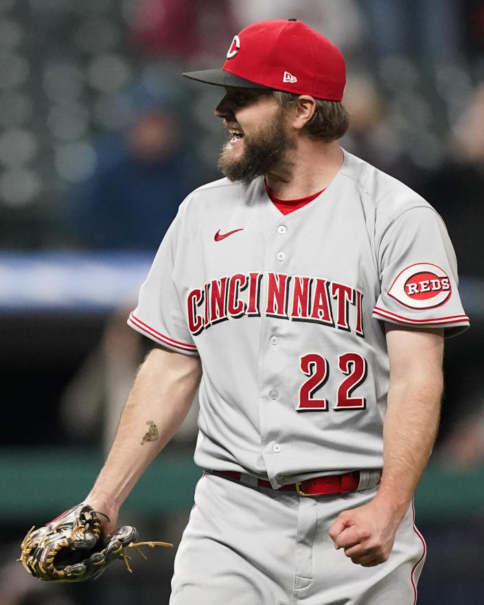 Cincinnati Reds starter Wade Miley pumps his fist as he starts to celebrate after pitching a no-hitter in a baseball game against the Cleveland Indians, Friday, May 7, 2021, in Cleveland. (AP Photo/Tony Dejak)